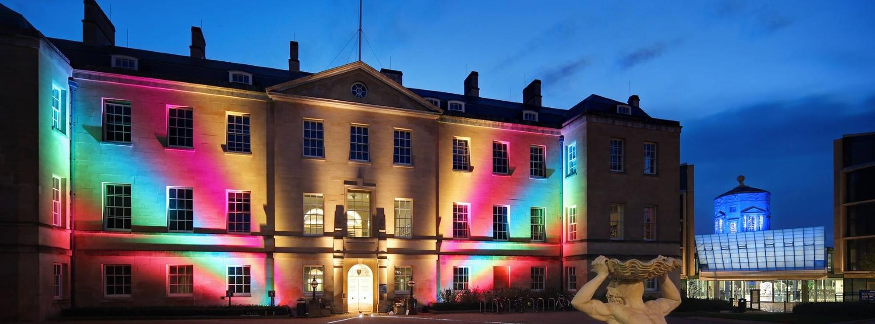 Front of TORCH building lit up with rainbow projections