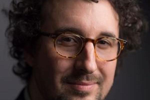 Daffyd Mills Daniel smiling at camera, wearing glasses