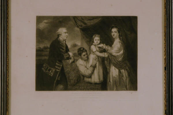 A painted family portrait, with drapery and scenic landscape in the background. Parents stand on either side of their child who is standing on a chair, supported by a woman leaning forward holding the child's dress.