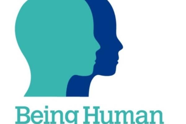 Being Human Festival Logo with two heads in profile together in blue and turquoise