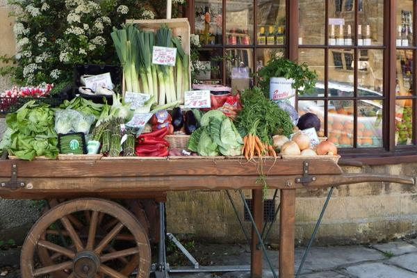 Wooden cart filled with fresh vegetables