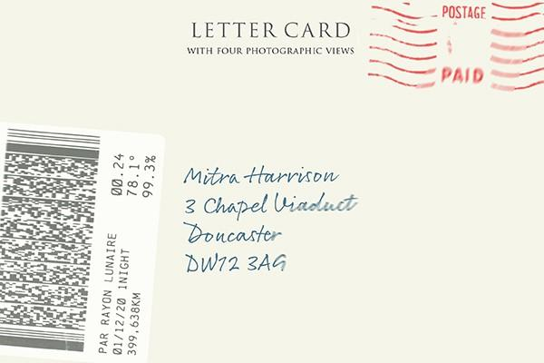 Image of the front of a letter with hand written name and address, postal stamp and barcode