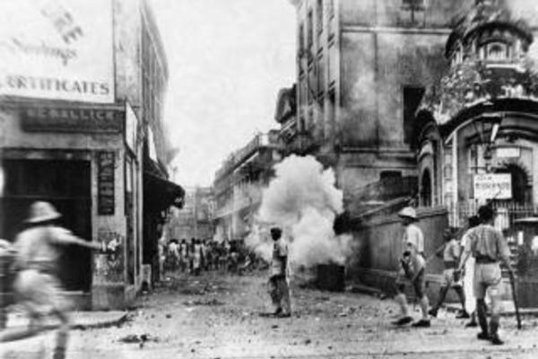 police use tear gas during a communal riot in calcutta in