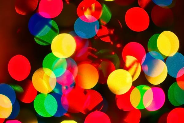 Image of many multicoloured, out of focus lights
