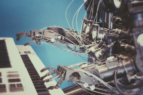 Image of a robot playing the piano