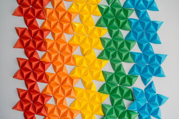 paper origami of stars in lines of red, orange, yellow, green, and blue