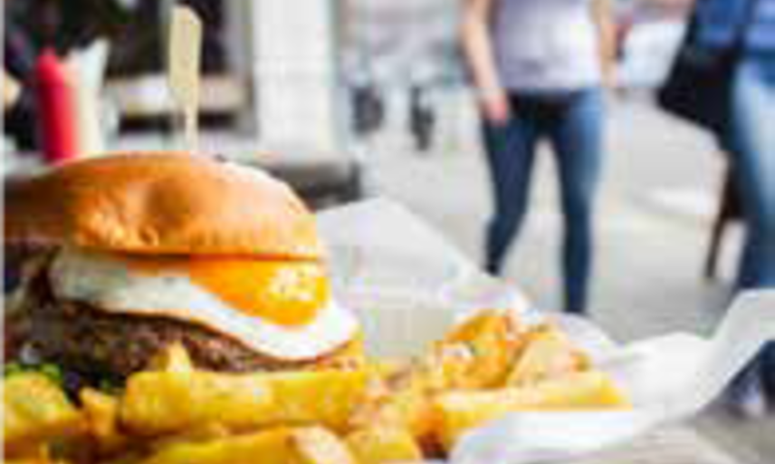 Image of a burger with egg and chips