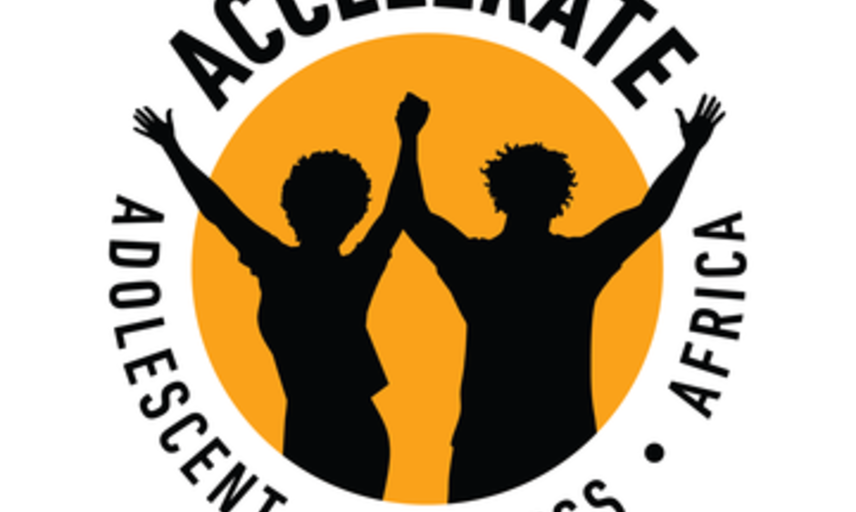 Yellow circle, black silhouettes of adolescents holding hands and cheering.