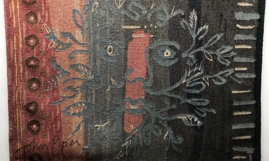 Picture of the tapestry in green, black and earthy colours.