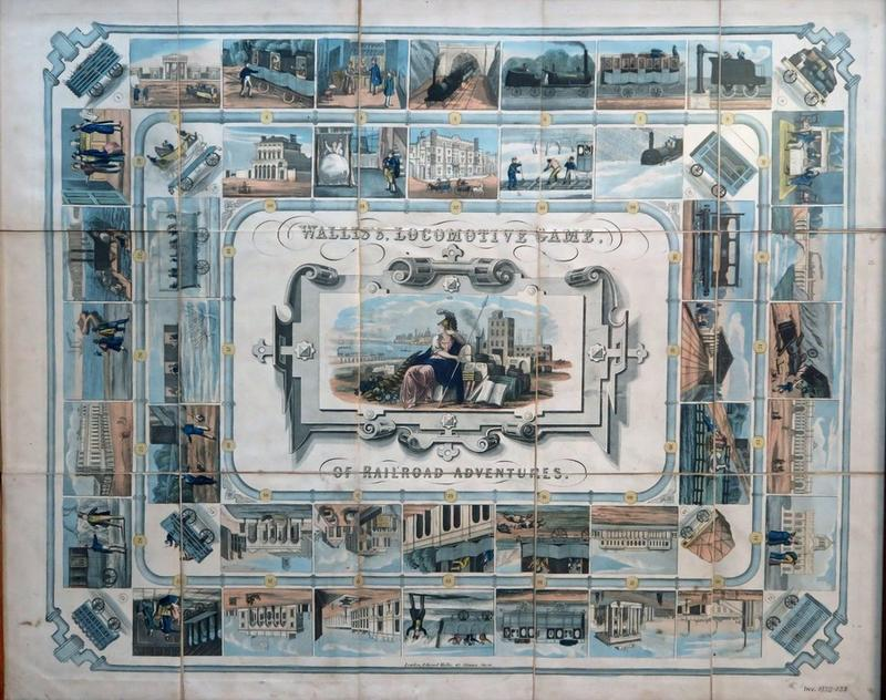 Picture of the Wallis's Locomotive Game. The principal colour is blue. It depicts a railway journey with each stop featuring a railway-related image.