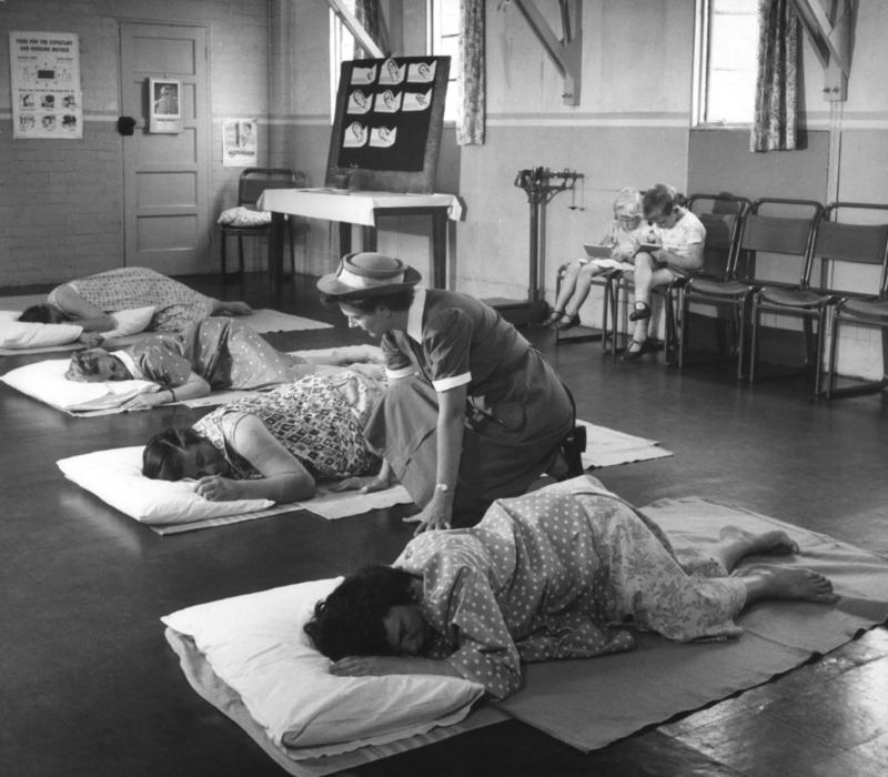 Black and white photograph of women preparing of labour in antenatal class