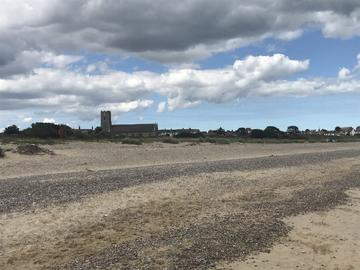 image of beach in Suffolk, with distant buildings in the distance
