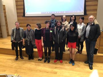 a few conference delegates pile in for a last minute photo with the organisers