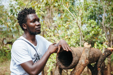 Man with a well as part of the building ugandas creative entrepreneurial community
