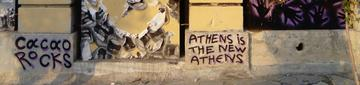 """The bottom of a mural in Metaxourgeio by Cacao Rocks stating, """"Athens is the new Athens"""", photo taken by the authors in July 2018"""