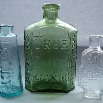 1280px three early medicine bottles