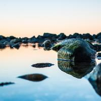 shore with mirroring stones
