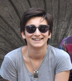 mirela ivanova smiling with bronze backdrop